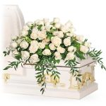 white roses casket spray